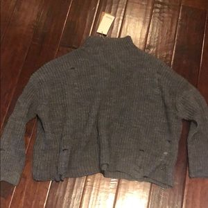 Italian brand sweater with intentional rip detail
